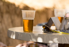 Beer in a glass on a table in a cafe Stock Images