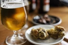 Beer glass with tapas food. royalty free stock photography