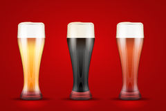 Beer glass with three brands Royalty Free Stock Photography