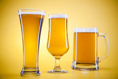 Free Beer Glass With Yellow Background Royalty Free Stock Image - 15991656