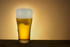 Beer. Glass beer on wood background with copyspace Stock Photo