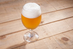 Beer glass on wood Stock Photos