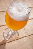 Beer glass on wood Stock Image