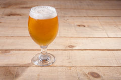 Beer glass on wood Royalty Free Stock Photo