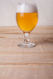 Beer glass on wood Stock Photography
