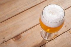 Beer glass on wood Stock Photo