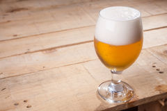 Beer glass on wood Royalty Free Stock Images