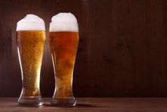 Beer in glass on wooden royalty free stock image