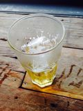Beer in the glass on wooden table Stock Photo