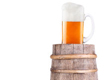 Beer glass on wooden vintage barrel Stock Image
