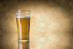Beer glass on yellow background Stock Photo
