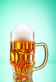 Beer glasses against the colorful gradient Stock Photography