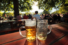 Beer glasses in a Bavarian Beer garden at Munich Stock Photo