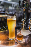 Beer glasses with beer on the bar 5 Stock Images