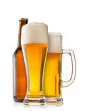Beer glasses with bottle on white background Stock Images