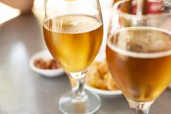 Beer glasses with plates to eat royalty free stock photos