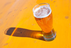 Beer glasses on wood background Stock Photo
