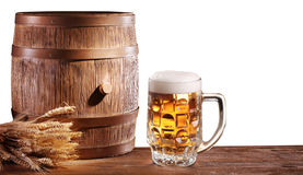 Beer glasses with a wooden barrel. Royalty Free Stock Image
