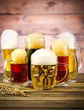 Beer glasses on a wooden table Stock Photo