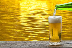 Beer with gold water ripple. Royalty Free Stock Images