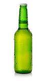 Beer in a green bottle Royalty Free Stock Images