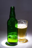 Beer green bottle with glass Stock Photos