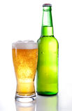 Beer in a green bottle and glass on a white Royalty Free Stock Photo