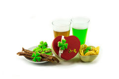 Beer green lager with a meat appetizer clover and gift box heart. St.Patrick `s Day Royalty Free Stock Photos