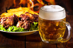 Beer and grilled chicken wings Royalty Free Stock Image