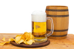 Beer in the grocery store with chips and barrel on white isolated background. Beer in the grocery store with chips and barrel royalty free stock image