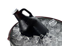 Beer Growler in Ice Bucket. A 64 ounce beer growler in a galvanized steel ice pail royalty free stock photos