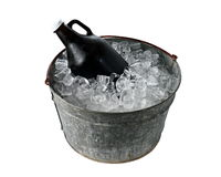Beer Growler in Ice Bucket. A 64 ounce beer growler in a galvanized steel ice pail stock photos