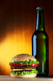 Beer and hamburger Stock Photography