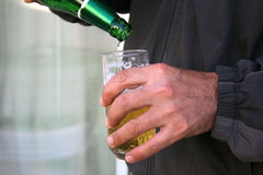 Beer in hand Royalty Free Stock Photo