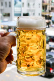 Beer in hand. Glass with beer in hand Royalty Free Stock Images