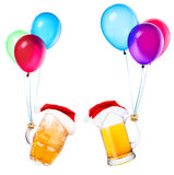 Beer with hat of Santa and balloons Royalty Free Stock Photos