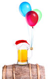 Beer with hat of Santa and balloons Stock Photo