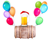 Beer with hat of Santa and balloons Royalty Free Stock Photography