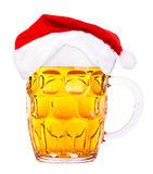Beer and hat of Santa Claus Stock Photo