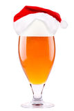 Beer and hat of Santa Claus Stock Image