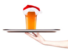 Beer and hat of Santa Claus Stock Photos