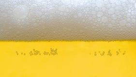 Beer head. Closeup of foaming beer head background Royalty Free Stock Photos