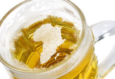 Beer head shaped as Africa in a beer mug.(series) Royalty Free Stock Photography
