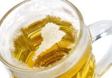 Beer head shaped as America in a beer mug.(series) Stock Photography