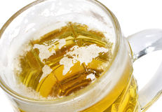 Beer head shaped as the world in a beer mug.(series) Royalty Free Stock Images