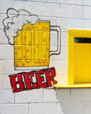 Beer here. Homemade beer ad on a white washed brick wall Royalty Free Stock Images