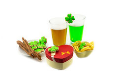 Beer with high foam green lager with snacks meat sticks gift box. St.Patrick `s Day Royalty Free Stock Photography