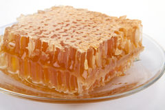 Beer honey in honeycombs. On a saucer Royalty Free Stock Photography