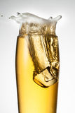 Beer with ice. Splash with drops Royalty Free Stock Photos