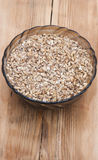 Beer ingredients. Pale malt barley in a glass bowl, an ingredient for beer Stock Photography